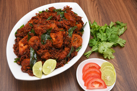 Fried chicken Kebab, Kerala Chicken fry or 65 is hot and spicy crispy chicken dish South India. Non vegetarian starter or quick snack. A popular authentic roasted dish deep fried Indian spices.