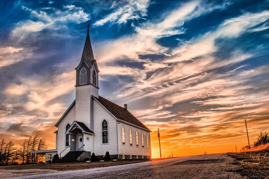Ellis County, KS, USA - A Lone Wooden Christian Church at Dusk Sunset Skies in the Western Kansas Prairie