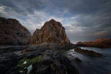 Coast with rocks and silky sea
