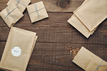 Paper bags with seeds for planting. Wooden table. View from above.