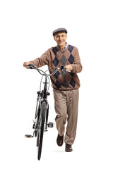 Elderly man pushing a bicycle and smiling at the camera