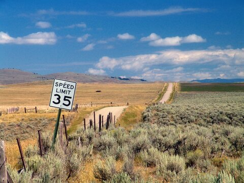 Empty country road with a speed limit of 35 mph in Montana, USA
