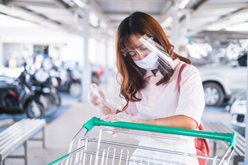 beautiful asian girl facemask face shield protection coronavirus covid-19, smart phone checking price payment shopping buying food grocery at super store market stock supply world pandemic quarantine