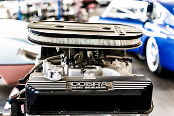 engine of a vintage ac cobra, british sportscar, roadster