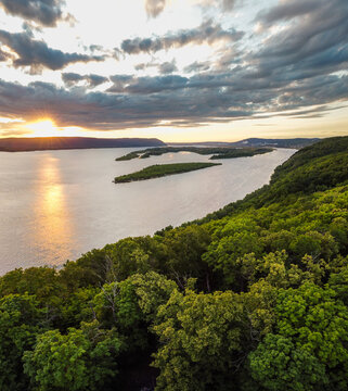 Aerial landscape view on Volga river with small sand islands and green forest on hills during summer sunset, Samara, Russia
