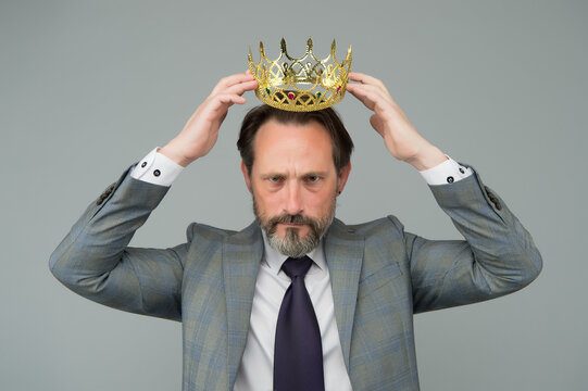 Kill your pride before you lose your head. Big boss wear crown with pride. Proud businessman grey background. Bearded man in formalwear. Pride and egoism. Pride and ambitions. Toxic ego