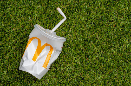 London, England - August 15, 2019: McDonald's Empty Cola Cup with Paper Straw, McDonald's is the world's largest chain of hamburger fast food restaurants.
