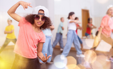 Afro girl hip hop dancer performing at class