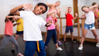 Kids training hip hop in dance studio
