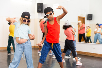 Kids hip hop dancers posing at studio