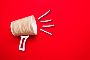 Takeaway coffee in shout concept on red background. Promotion or advertising sale.