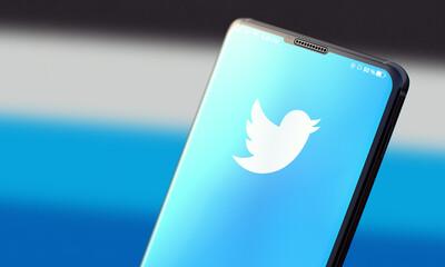 KYIV, UKRAINE-JUNE, 2020: Twitter. Studio Shot of Cellphone with Twitter Mobile Application on Blurred Back.