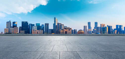 Hangzhou city skyline and commercial buildings with empty square floor,China.