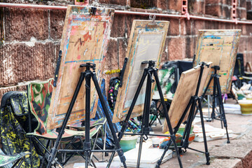 Easels by wall at old street of Phoenix Ancient Town