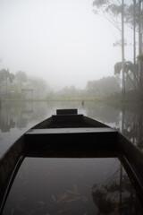 Boat in a foggy lake