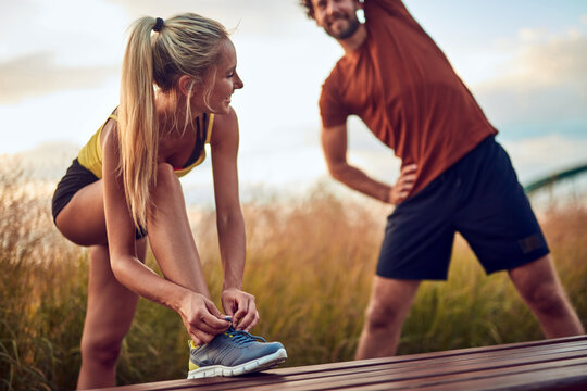 Young adult sporty couple working out outdoors.