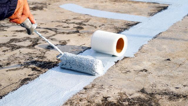 Waterproof and water leak,Hand painted gray flooring with paint rollers for waterproof, reinforcing net,Repairing waterproofing deck flooring.
