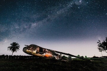 Picture of an abandoned plane under the starry sky