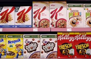 Breakfast cereals of producers Nestle and Kellogg are displayed at a supermarket of Swiss retailer Denner in Glattbrugg