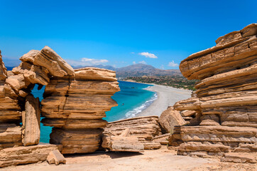 The long sandy beach of Triopetra in south Crete.The beach is named after the three rocks in the sea.