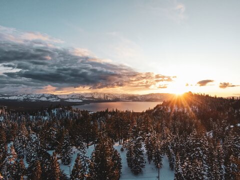 Aerial view of the Lake Tahoe captured on a snowy sunset in California, USA