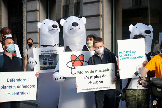 """Members of the group """"The Voices of Nuclear"""" demonstrate in reaction to the closure of the Fessenheim nuclear power plant in front of Greenpeace headquarters in Paris"""