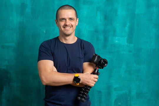 Portrait of man videographer or blogger with camera