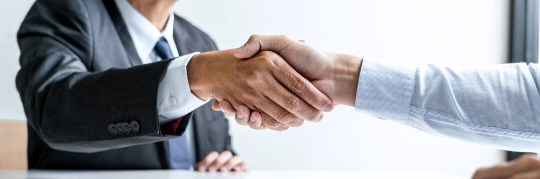 Male candidate shaking hands with Interviewer employer after a job interview