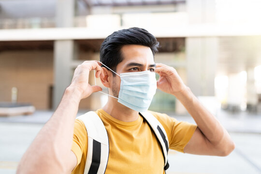 Young Man Wearing Face Mask In City