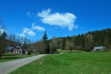 Czech Republic - view of wooden house in Antonin valley in spring near town Svoboda n / U