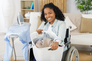 happy disabled woman during ironing