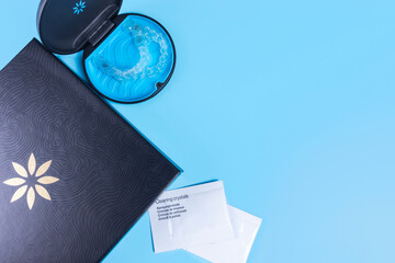 Invisible transparent aligners invisalign blue package with a box, clear-plastic retainers and cleaning crystals. With copyspace for banners and websites