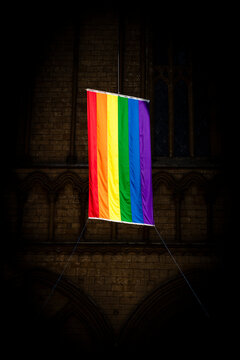 Peterborough, Cambridgeshire, UK, July 2019, A view of a Pride flag hanging from Peterborough Cathedral