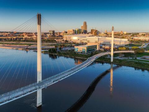 Bob Kerry Pedestrian Bridge spans the Missouri river with the Omaha Nebraska skyline in the background.