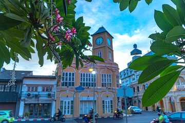 sunset above the ancient building architectural style in Phuket city was built in Chino portuguese style..clock tower is a landmark of Phuket city.
