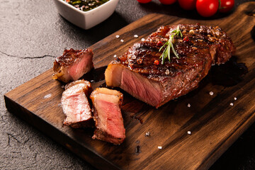 Fresh grilled meat. Grilled beef steak medium rare on wooden board. Picanha. Top view.