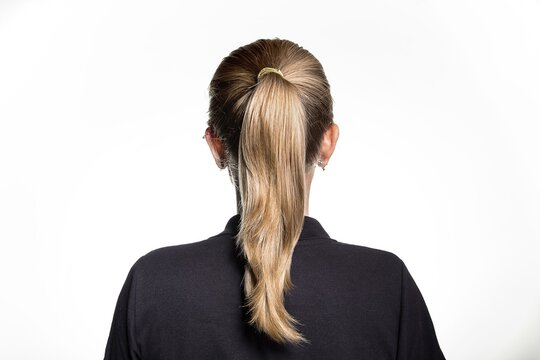 Back view of young female dirty blonde hair straight hair ponytail black shirt white background