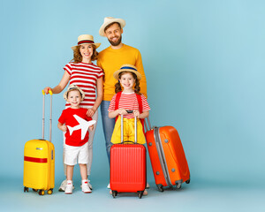 Cheerful modern family with suitcases.