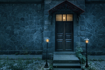 Old rustic classical stone house and brown vintage wooden door with wrought iron.