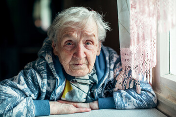 Portrait of a retired elderly woman. In her house.