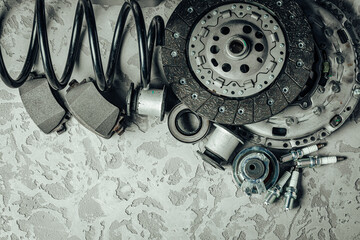 Car parts on grey textured concrete background