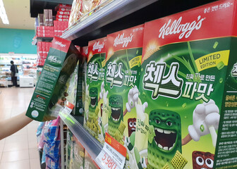 A clerk displays Kellogg's green onion-flavored cereal at a supermarket in Seoul