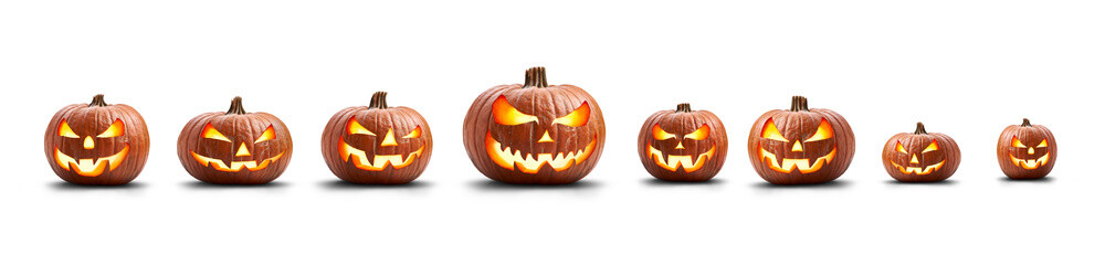 A group of eight lit spooky halloween pumpkins, Jack O Lantern with evil face and eyes isolated against a white background.