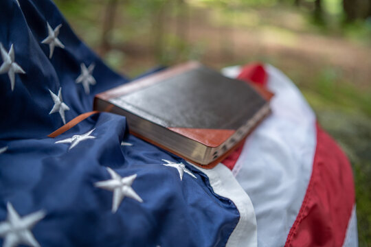 Bible resting on American flag