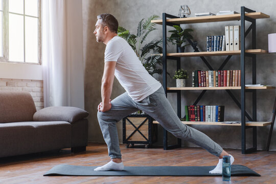 Middle age man doing fitness workouts at home