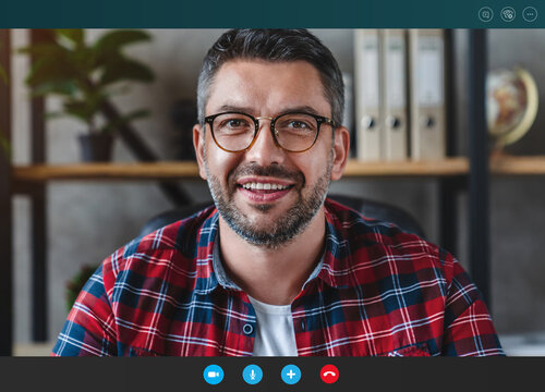Cheerful business man looking camera webcam making conference video call
