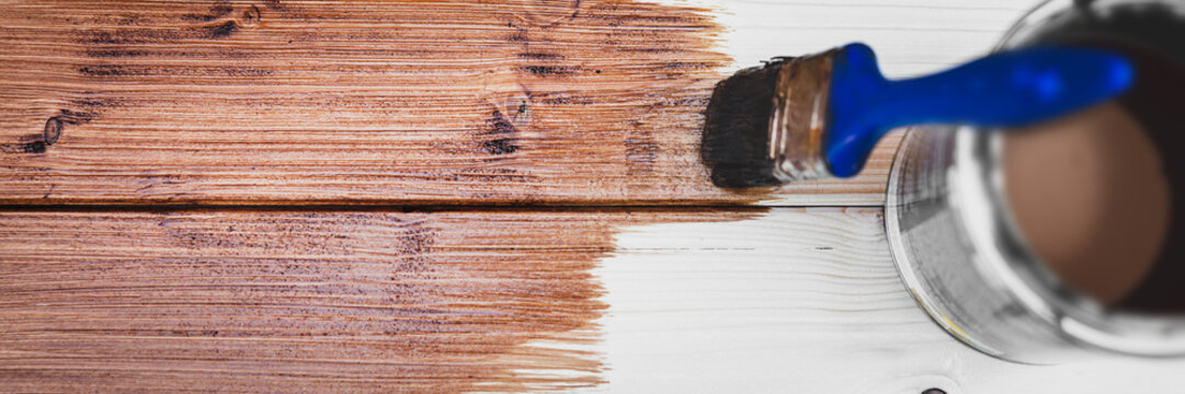 panorama of a wooden board with a brush and brown glaze