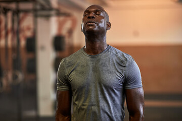 Fit young man sweating after a gym workout