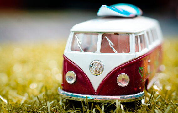 London, England - August 11, 2018: Model of a VW Volkswagen Camper Van with Surfboard, The Type T2 Split Screen was first introduced in 1950