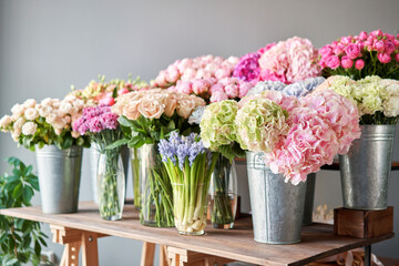 Many different colors on the stand or wooden table in the flower shop. Showcase. Background of mix...